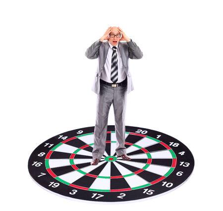 strategizing: Businessman  placed on a dartboard
