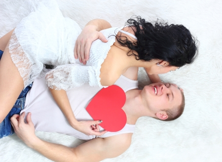 sexy young couple before kiss, lie on the floor photo
