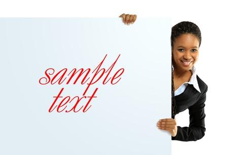 空白記号を保持しているアフリカ系アメリカ人の女性 写真素材