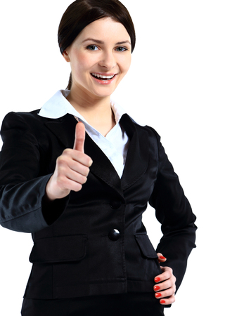 Happy smiling business woman with thumbs up gesture photo