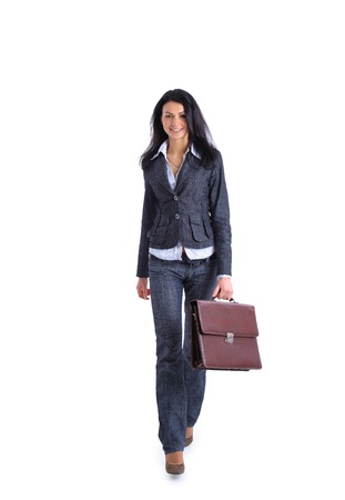 Full length image of confident business woman going and holding a briefcase
