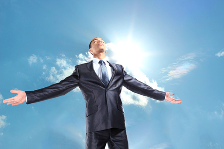 arms  outstretched: Happy businessman standing outside with arms outstretched