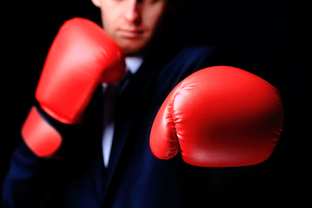 businessman in boxing gloves isolated on black Stock fotó