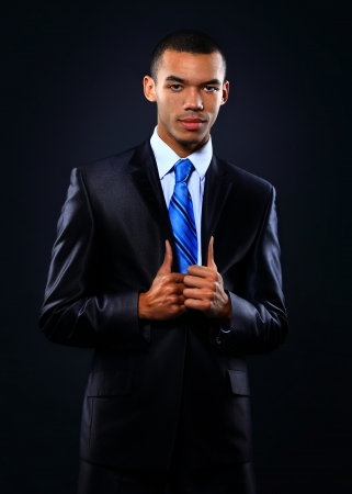 Young handsome African-American businessman in black suit. Stock Photo - 24645496