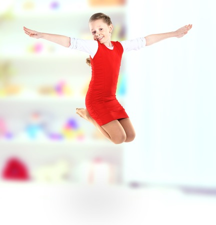 girl jumps photo