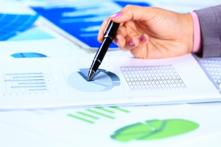 money matters: Close up of female hands reviewing accounting documents