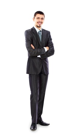Full length portrait of a young businessman standing with his hands holding  Stock fotó