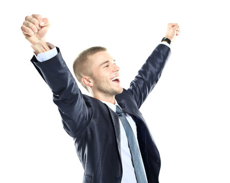 Excited handsome business man with arms raised in success - Isolated on white photo