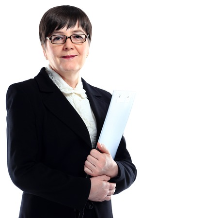 Mature adult businesswoman in a black suit holding a black folder photo