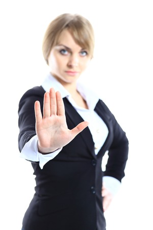 disclaim: Business woman making stop sign over white, focus on hand Stock Photo