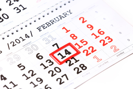 st mark: Sheet of wall calendar with red mark on 14 February - Valentines day Stock Photo