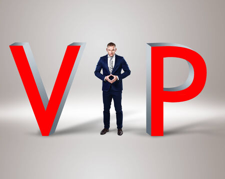 privileges: Young businessman in the middle of word vip on background