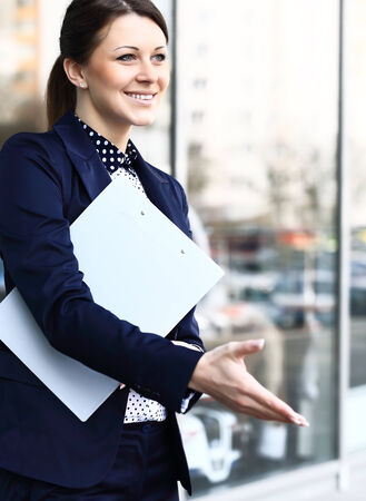 Business woman with arm extended for a handshake photo