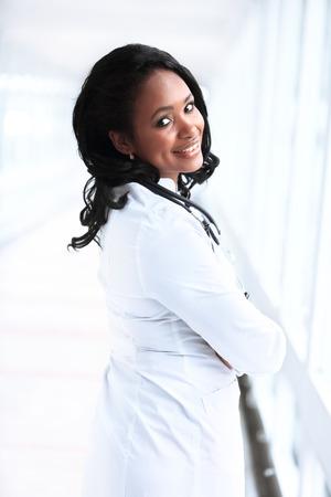 beautiful african american female pediatric nurse in modern office photo