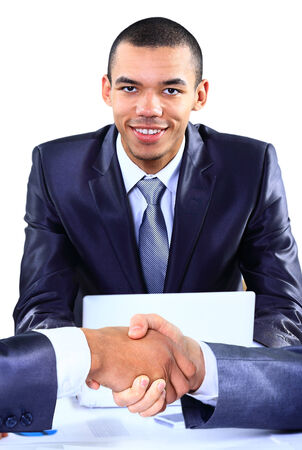 Happy  young african american businessman working on laptop computer photo