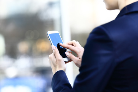 Close up of a woman using mobile smart phone Stock fotó