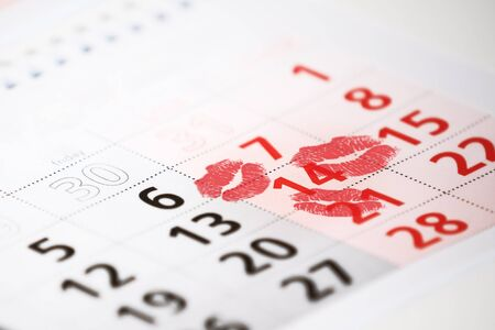 saint valentine's day: Calendar page with the red kisses on February 14 of Saint Valentines day. Stock Photo