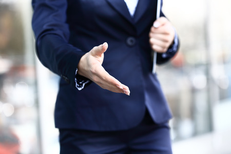 arm extended: Business woman with arm extended for a handshake