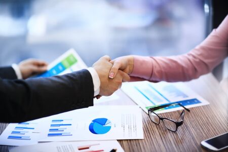 technology deal: Business people shaking hands