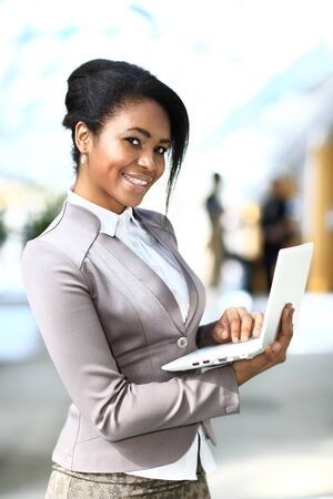 african business: beautiful young african american businesswoman working on computer