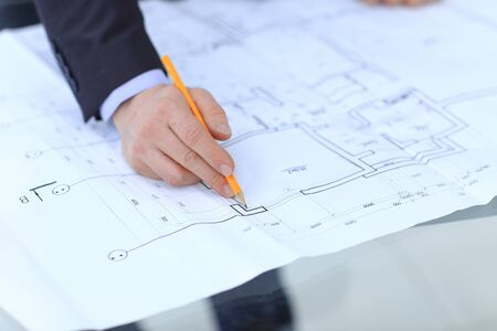 architect drawing: Architect designing house for client in office