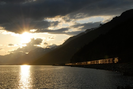 Moose Lake in Mt  Robson Provincial Park,freight train running on its lakeside,and the setting sun,Canadian Rockies  ,Canada photo