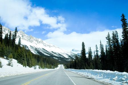 rockies: Road in Canadian Rockies in Winter, Alberta, Canada Stock Photo