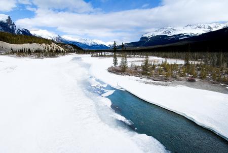 rockies: North Saskatchewan River in Winter, Canadian Rockies, Alberta, Canada Stock Photo
