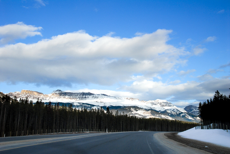 extensive: Road in the Evenin in Winter, Canadian Rockies, Alberta, Canada Stock Photo