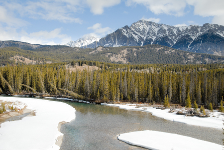 Grand View of Bow River and Mountain Range in Winter, Canadian Rockies, Alberta, Canada
