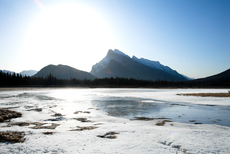 Cascade Mountain and Vermilion Lake in the Morning in Winter, Canadian Rockies, Alberta, Canada Stock Photo