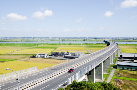 Highway and Paddy Field in Harvest Season (Sawara, Chiba, Japan)