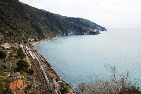 Corniglia railway station and Distant view of Manarola-Cinque Terre (5 Terre), Five village on the Italian Riviera, Ligu RIA, Italy