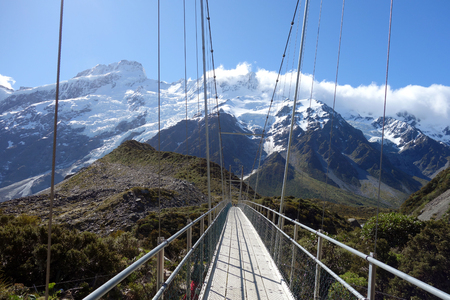hooker: Beautiful swing bridge in Hooker Valley, Mount Cook, New Zealand Stock Photo