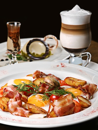 Breakfast eggs as Irish with bacon and vegetable photo