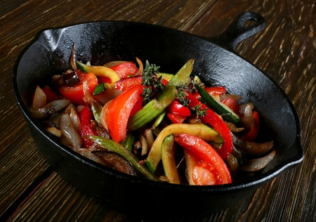 panful: Fried vegetable with spice in black pan