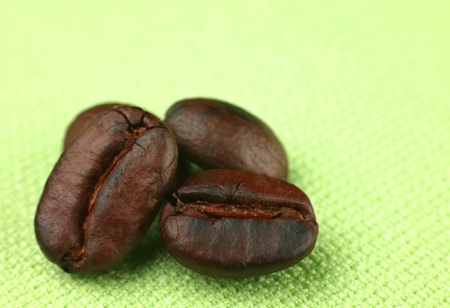 geen: Brown fried coffee bean on geen background  Stock Photo