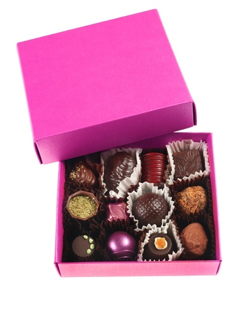 Chocolate candy group in pink box on white Stok Fotoğraf