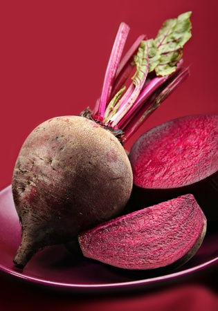 Beetroot purple vegetable on purple background