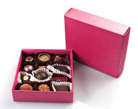 Chocolate candy group in purple box on white