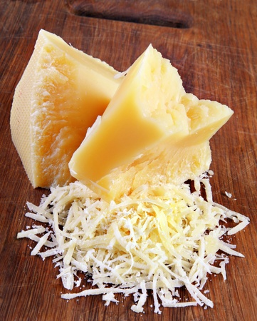 Dairy product parmesan cheese grated on board