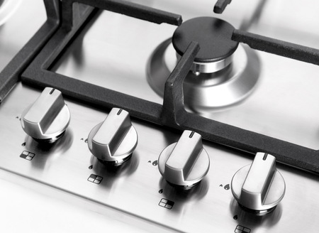 kitchen appliances: Element gas burner detail oven domestic kitchen Stock Photo