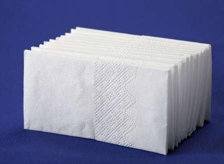 Hygiene paper tissue pile closeup on blue background Stok Fotoğraf