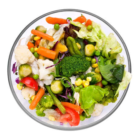 Warm vegetable salad in glass with herb photo