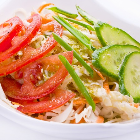 slice tomato: Vegetable salad with slice tomato and cucumber Stock Photo