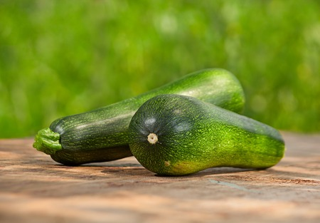 zucchini vegetable: Fresh zucchini vegetable on wood table