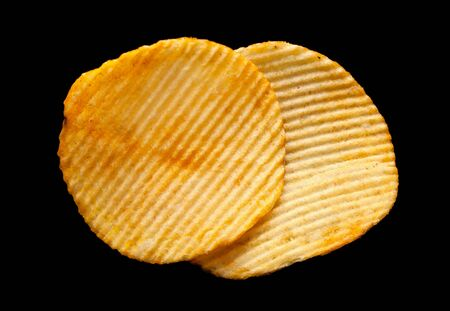 potato chips: Potato ripple chips snack isolated on black background Stock Photo