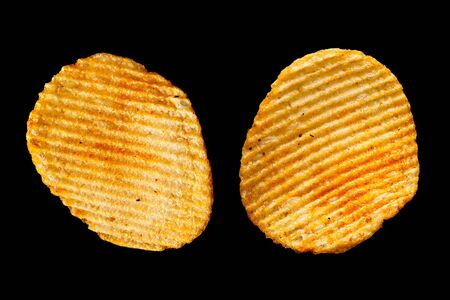 ribbed: Ribbed potatoes snack with pepper isolated on black background Stock Photo