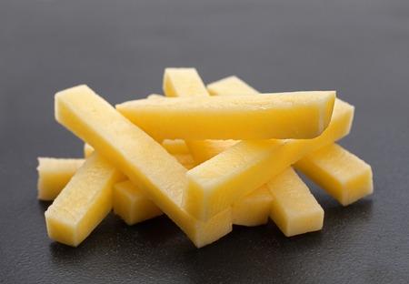 potatoe: Potatoe stick vegetable closeup on dark background