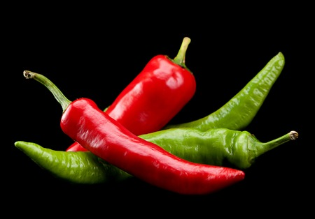 Red and green chili pepper isolated on black Stock Photo